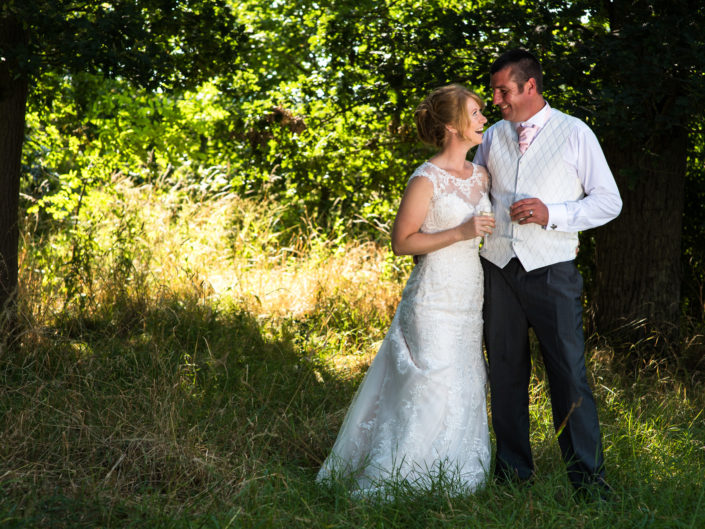 Kif and Becky on their wedding day taken in woods on their farm by Kent wedding photographer Helen Batt
