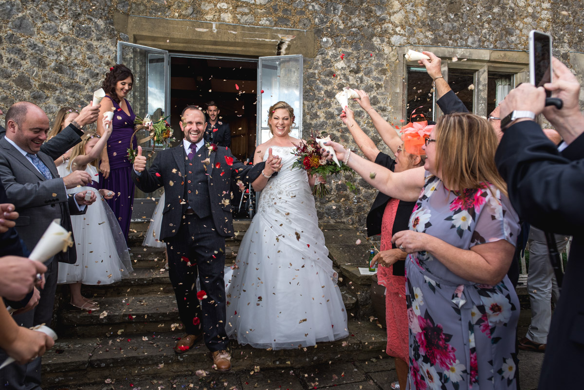 Wedding confetti photograph at John and Liannes Lympne Castle wedding in Kent