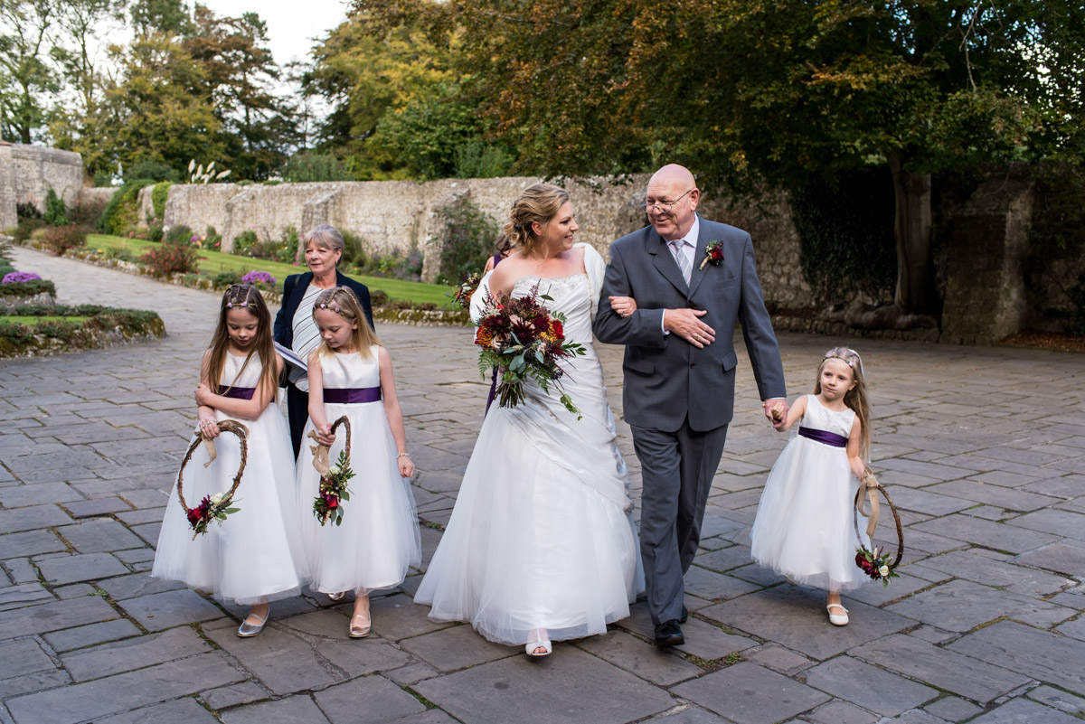 Photograph of Lianne & her father along with mum and flower girls before the ceremony at Lympne Castle In Kent
