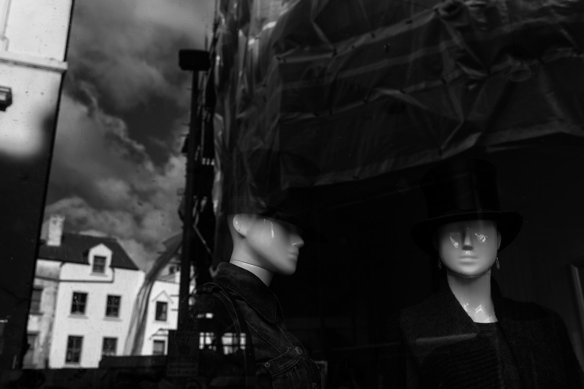 Black and white photograph of mannequins and reflections of buildings in Folkestone Kent